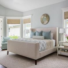 Restful beige and blue bedroom is furnished with a beige wingback bed dressed in beige and blue bedding accented with blue pillows. Blue Bedroom Colors, Bedroom Color Schemes, Blue Rooms, White Rooms, Greek Bedroom, Seaside Bedroom, Bedroom Decor, Master Bedroom, Bedroom Inspo