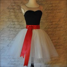 On sale-- 1/2 price short tulle skirt! $110, (usual price is $235)  Details:  29 waist, ivory duchesse lining 14.5, tulle 17, red satin sash