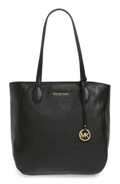 In love with this essential Michal Kors tote in a classic and easy to pair color.