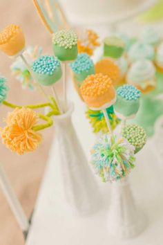 "Ignore the colors, but the pompoms, marshmallows and cake decorations as centerpiece ""flowers"" could also be used along with your paper flowers. Marshmallow ones could be favors."