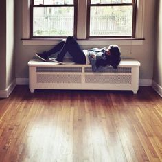 radiator or sleeping bench!? just straight chilling...in our new house!!!