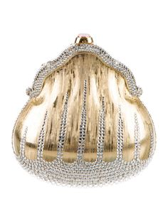 Gold-tone Judith Leiber minaudière with gold-tone hardware, single drop-in shoulder strap with chain-link accent, clear crystal embellishments throughout, metallic gold-tone leather interior and embellished push-lock closure at top. Includes compact mirror, coin purse, comb and dust bag. Shop authentic designer handbags by Judith Leiber at The RealReal.