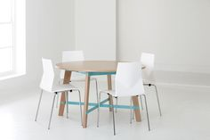 Teton round combines a wood finishes with a nice pop of color to brighten up any space.