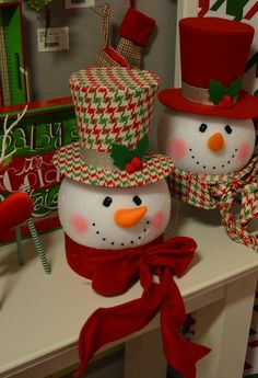 Shelley B Home and Holiday - RAZ Snowman Head Christmas Tree Topper Holly Houndstooth, $36.99 (http://shelleybhomeandholiday.com/raz-snowman-head-christmas-tree-topper-holly-houndstooth/). shop for more red green and white houndstooth design Christmas ornaments here: