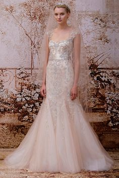 Monique Lhuillier Fall 2014 Romance - Blush embellished tulle modified trumpet gown with illusion cap sleeves, keyhole back and self beaded sash