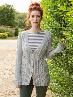 With intertwining cables on the front and back, Woodrush is a v-neck cardigan that is worked in pieces and seamed. Pattern is charted.