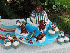 Rainbow cake with monkeys floating on the clouds....