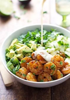 This spicy shrimp and avocado salad has cucumbers, spinach, shrimp, and avocado with a creamy miso dressing - so yummy!