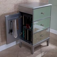 Mirrored dresser with stash spots for all your jewelry. great so i don't have take up room on a dresser or somewhere.