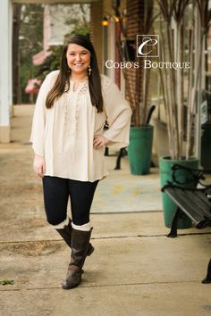 This is one of our staffs favorites tops for sure! We have it in taupe and turquoise! Call 601.591.4111 to order! We are open until 6pm!
