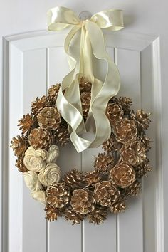 My newest wreath! Gold pinecone wreath with wooden balsa flowers Winter Christmas, Christmas Holidays, Christmas Wreaths, Christmas Decorations, Fall Crafts, Holiday Crafts, Pine Cone Decorations, Pine Cone Crafts, Diy Wreath