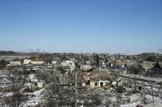 Buildings damaged by fighting are pictured in the village of Nikishine, south east of Debaltseve, Ukraine February 17, 2015. REUTERS/Baz Ratner