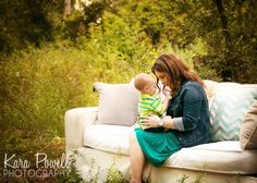 Woodlands, TX one year old having a quiet moment with mom on a couch in a field, taken by Kara Powell Photography.