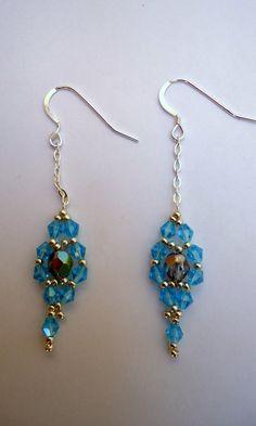 Beaded earrings in a flower pattern with blue by JoolsbyAveril