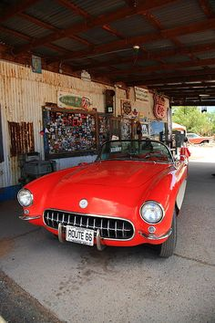 A red Corvette parked on Route 66 in Arizona.