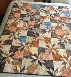 Hunter's Star quilt made with batiks, shown on The Quilting Board website.