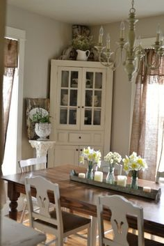 Wood Table With White Chairs And White Corner Hutch