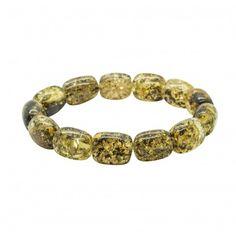Elegant bracelet en ambre naturel de couleur vert avec grosse perle d'ambre cylindrique. Taille adulte. Longueur des pierres: 1.3 - 1.5 cm Diamètre du bracelet: 6 cm Circonférencedu bracelet: 18cm Poids approximatif: 15-16 grammes et 18 grammes