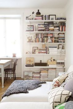 Small Space Secrets: Swap Your Bookcases for Wall Mounted Shelving wall mount shelves, bedroom shelves, small space organization, bookcas, wall mounted shelves, small spaces