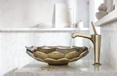 Margaux® single-handle faucet     Briolette™ Vessel sink     The faucet's gold finish brings out the warm golden hues in the tile and sink.