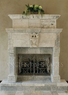 An antique Stone fireplace mantle. Photo By http://www.ancientsurfaces.com Phone: 212-461-0245