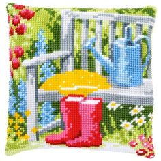 A colourful design with garden seat, watering can, wellies and flowers.