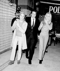 Alain Delon with Nathalie and Brigitte Bardot in 1967.