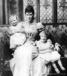 Princess Mary of York with her children Prince Albert (left) and Prince Edward (right).  Both boys are still young enough to be in dresses.