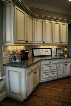 I'm really leaning towards creme colored cabinets with a dark glaze on