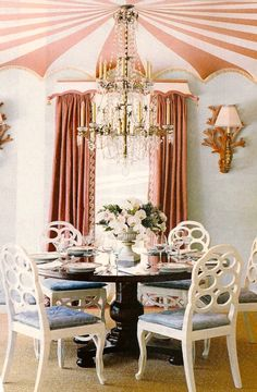 Richard Keith Langham on design crack? I don't know, but I am IN LOVE with this dining room. Loopy Elkins chairs, a circus tent style painted ceiling (complete with fringe!!), big ol' coral sconces, a chandelier with stars in it (!!), wave pattern tape on the leading edge of the drapes, and a shallow scalloped pagoda shaped pelmet with little bells on the end!
