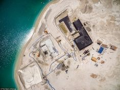 An overhead image from July last year shows work continuing on villas on an island represe. Continents, Villas, Making Out, Dubai, Around The Worlds, Map, Island, How To Plan, Mansions