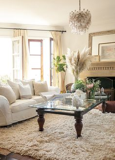 A neutral white-on-white living room (Source: Lonny / Michael Wells) Love the cream rug and light mantle