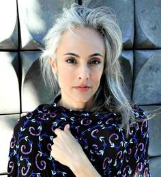 Natural grey hair on women is beautiful. Model showing that grey hair is lovely and can look good on anyone who may be brave enough.