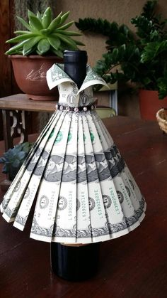 """Wine bottle cover - Wedding Gown - """" Best Picture For weird trends For Your Taste You are looking for something, and it is going t - Dollar Bill Origami, Money Origami, Dollar Bills, Money Lei, Origami Boxes, Origami Ball, Origami Paper, Money Rose, Money Bouquet"""