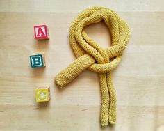 Hand knitted merino baby SCARF newborn and children one size Baby Scarf, Hand Knitting, Baby Shower Gifts, Warm, Trending Outfits, Unique Jewelry, Handmade Gifts, Yellow, Children