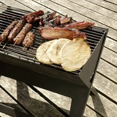 """super slim, portable charcoal grill that lives up to its boast as a """"notebook.""""   """"Notebook Portable Grill"""" from aplusrstore.com"""