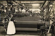 a weaver working a mechanical loom in Home mill at the end of 19th century