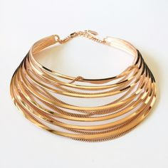 Jenny Bird Rose Gold Illa Collar. Make a statement with this fabulous necklace. The under-mounted chain adds movement to the hand-fabricated frame. 14k Rose Gold- Dipped Brass. High Polish. Also available in Gold. A225 Jenny Bird Jewelry Necklaces