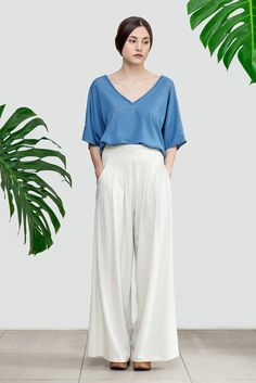 """Wide leg palazzo pants with pockets. Cut with a high-rise fit, softly pleated to flatter at the front, with an elasticated waistband at the back- for that great fit. It could be made in jersey cotton fabric for casual everyday use or in satin fabric for weddings and parties.  ▶Colors: Black, Charcoal Grey, Chocolate, Navy Blue, Dusty Blue, Yellow Mustard, Ivory or White  ▶Material: 100% cotton  Here's a size guide:  size S (US 4-6, UK 8-10) bust: 85-90 cm / 33.5""""-35.5"""" waist: 66-71 cm &#..."""