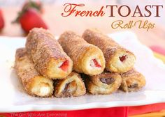 French Toast Roll-Ups     8 slices white sandwich bread     softened cream cheese, diced strawberries, or Nutella     2 eggs     3 tablespoons milk     1/3 cup granulated sugar     1 heaping teaspoon ground cinnamon     butter, for greasing the pan