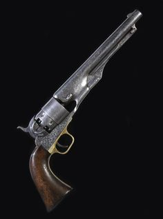 An historic Gustave Young deluxe engraved Colt.  Model 1860 Army percussion revolver with rare double presentation