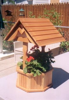 Handmade cedar wishing well planter.