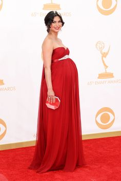 Emmy Awards 2013: Morena Baccarin <3 The pregnant Homeland actress showed off her curves in a strapless red gown with a diamond belt, accessorized with Fred Leighton jewels.