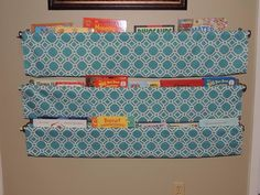 Very simple book racks! Made with double curtain rod brackets and inch X 48 inch dowels from Lowes.