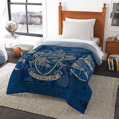 If you can't be a student at Hogwarts, you can at least pretend with one of these Harry Potter House Comforters.