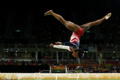 Routine: Simone Biles (above) scored a 15.300 on the balance beam for the women's finals on Tuesday in Rio