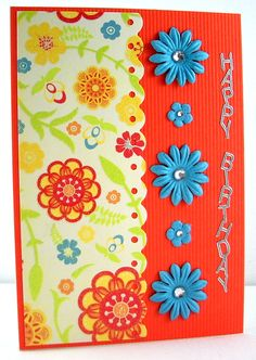 Flower power  Supplies:  white card base, orange ribbed cardstock, patterned card from DCWV Citrus Stack, Hero Arts flowers, Portacraft rhinestones, glue dots, hb sticker, ds tape.  Tools:  Fiskars Threading Water border punch.