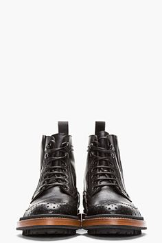 Lanvin.  I have a pair of boots that I bought on South Street in Philly when I was in college that look almost exactly like these.  Now they're back in style!