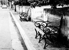 Wrought iron benches along a street in Intramuros. Old world charm.