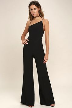 They're bound to stop and stare when they see you in the Lustrous Look Black Jumpsuit! Medium-weight woven fabric shapes an asymmetrical, princess-seamed bodice supported by spaghetti straps. Wide pant legs flow below a fitted waist. Hidden back zipper/clasp.